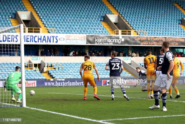 Mathieu Smith of Millwall scores his team's first goal during the FA Cup Third Round match between Millwall FC and Newport County AFC at The Den on...