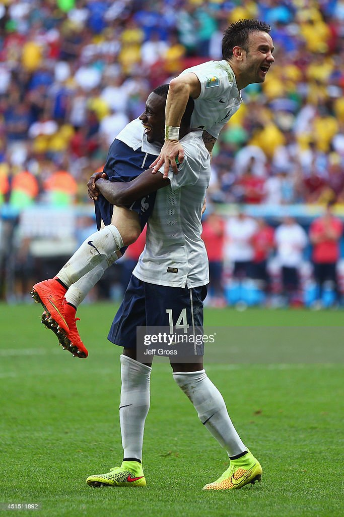 Mathieu Valbuena and Blaise Matuidi of France celebrate after defeating Nigeria 2-0 during the 2014 FIFA World Cup Brazil Round of 16 match between France and Nigeria at Estadio Nacional on June 30, 2014 in Brasilia, Brazil.