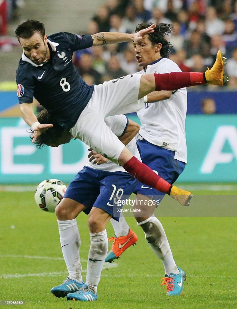 Mathieu Valbuena of France and Bruno Alves of Portugal during the International Friendly Soccer match between France and Portugal at Stade de France on october 11, 2014 in Paris, France.