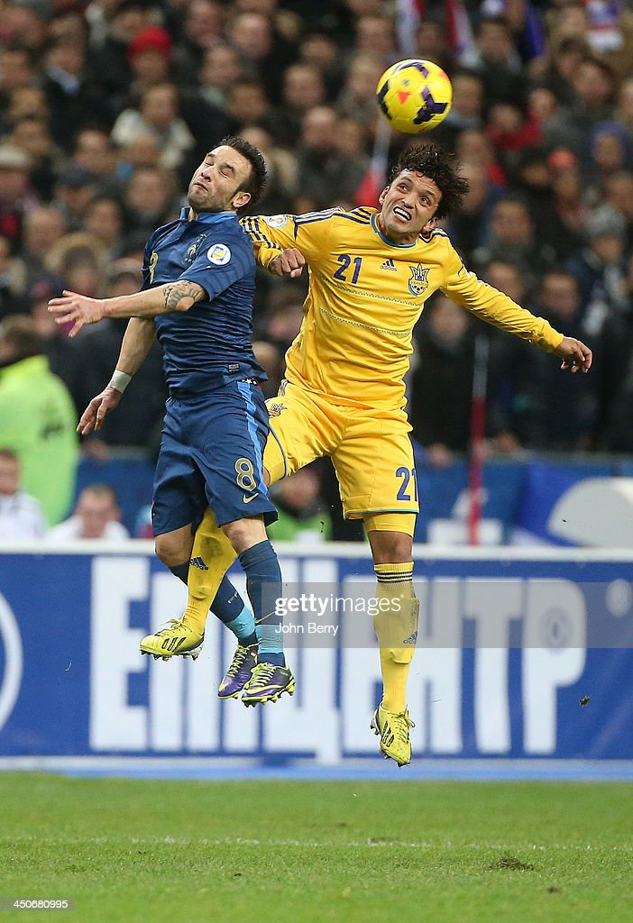 Mathieu Valbuena of France and De Lacerda Edmar of Ukraine in action during the the FIFA 2014 World Cup Qualifier play-off second leg match between France and Ukraine at the Stade de France on November 19, 2013 in Paris, France.