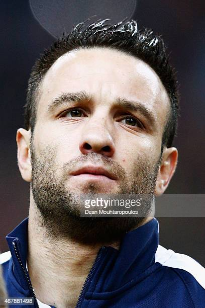Mathieu Valbuena of France stands for the national anthem prior to the International Friendly match between France and Brazil at the Stade de France...