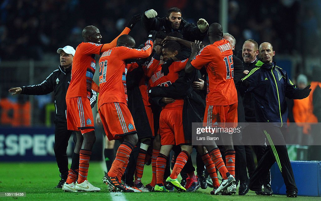Mathieu Valbuena of Marseille celebrates with team mates after scoring the winning goal during the UEFA Champions League group F match between Borussia Dormtund and Olympique de Marseille at Signal Iduna Park on December 6, 2011 in Dortmund, Germany.