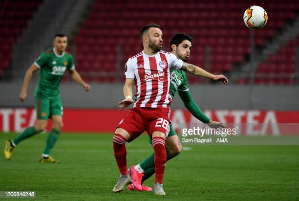 Mathieu Valbuena of Olympiacos FC and Pedro Neto of Wolverhampton Wanderers during the UEFA Europa League round of 16 first leg match between...