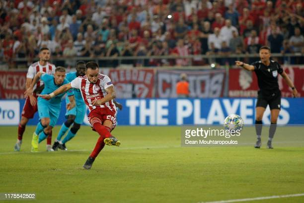 Mathieu Valbuena of Olympiacos scores his sides second goal from the penalty spot during the UEFA Champions League group B match between Olympiacos...