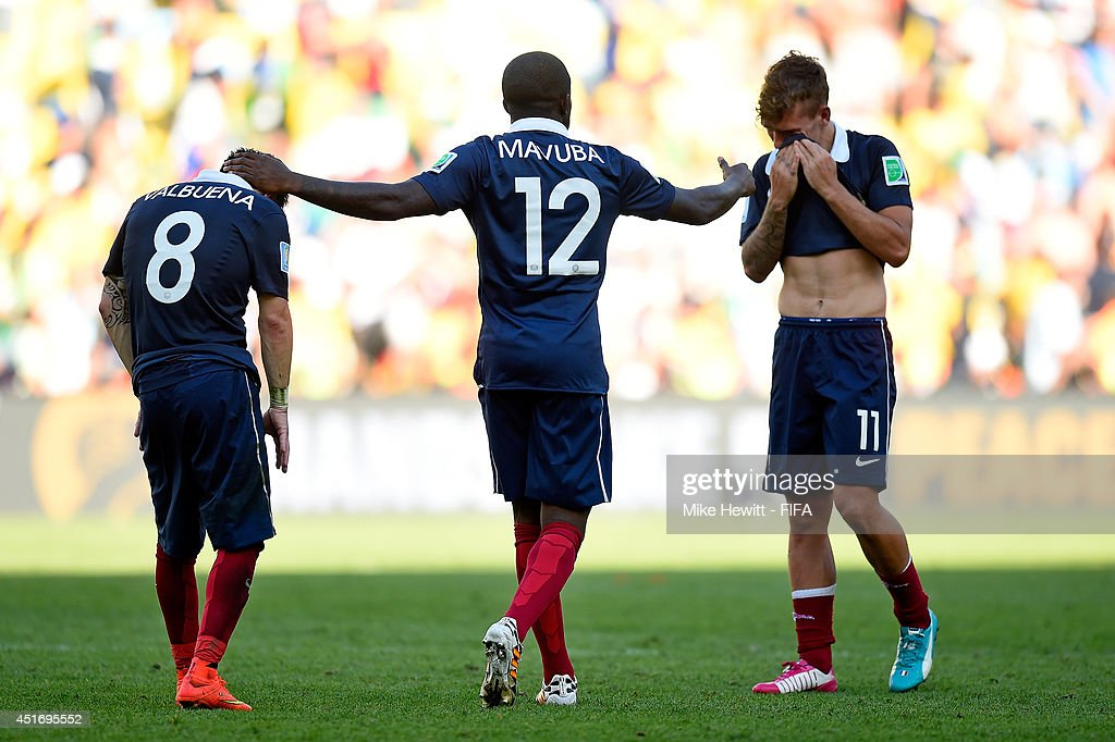 Mathieu Valbuena, Rio Mavuba and Antoine Griezmann of France react after the 0-1 defeat in the 2014 FIFA World Cup Brazil Quarter Final match between France and Germany at Maracana on July 4, 2014 in Rio de Janeiro, Brazil.