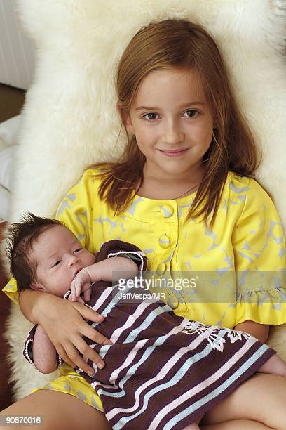 ACCESS* Mathilda Ereni daughter of Molly Ringwald and her husband Panio Gianopoulos poses with her newborn sister Adele Georgina during a photo shoot...