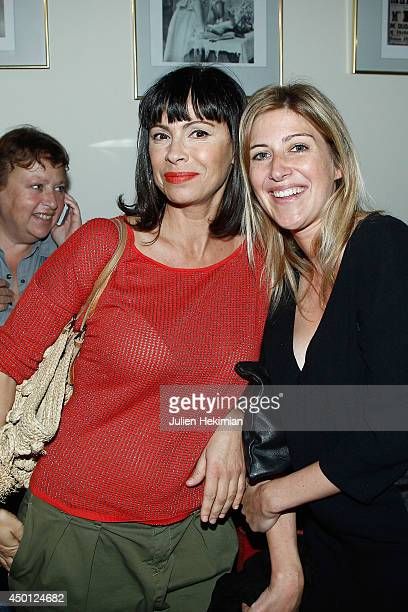 Mathilda May and Amanda Sthers pose after 'Le Mur' Theater Play Premiere on June 5 2014 in Paris France