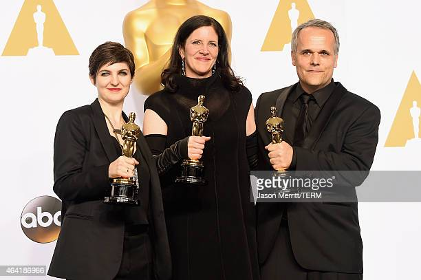 Mathilde Bonnefoy, director Laura Poitras, and Dirk Wilutzky, winners of est Documentary Feature Award for 'Citizenfour' pose in the press room...