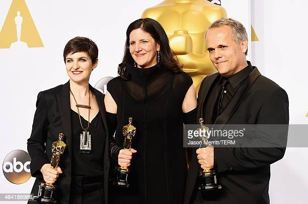 Mathilde Bonnefoy director Laura Poitras and Dirk Wilutzky winners of est Documentary Feature Award for 'Citizenfour' pose in the press room during...
