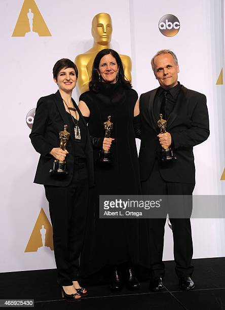 Mathilde Bonnefoy, director Laura Poitras, and Dirk Wilutzky, winners of est Documentary Feature Award for 'Citizenfour' pose inside the press room...
