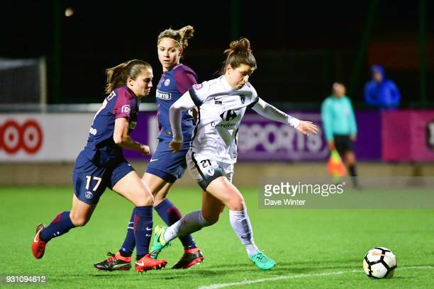 Mathilde Bourdieu of Paris FC powers past Erika Cristiano Dos Santos of PSG and Eve Perisset of PSG to score a late consolation goal during the...