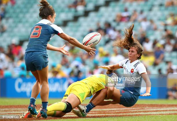 Mathilde Coutouly of France offloads in the womens pool match between Australia and France during day one of the 2018 Sydney Sevens at Allianz...