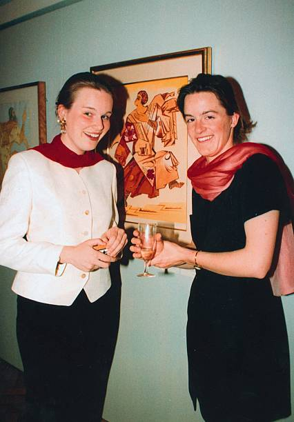 mathilde-dudekem-dacoz-poses-with-friend-and-a-painting-picture-id160954819