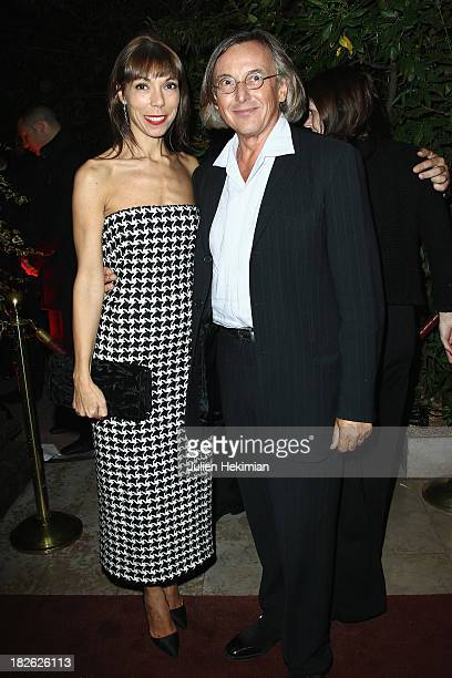 Mathilde Favier and Pierre Passebon attend the 'Mademoiselle C' cocktail party at Pavillon Ledoyen on October 1 2013 in Paris France