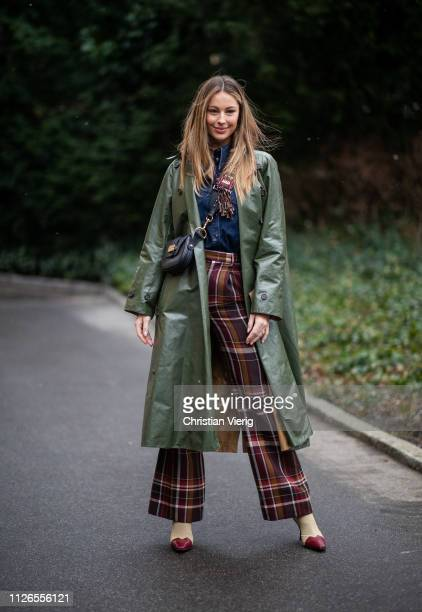 Mathilde Gøhler is seen wearing olive coat checked pants outside By Malene Briger during the Copenhagen Fashion Week Autumn/Winter 2019 Day 3 on...