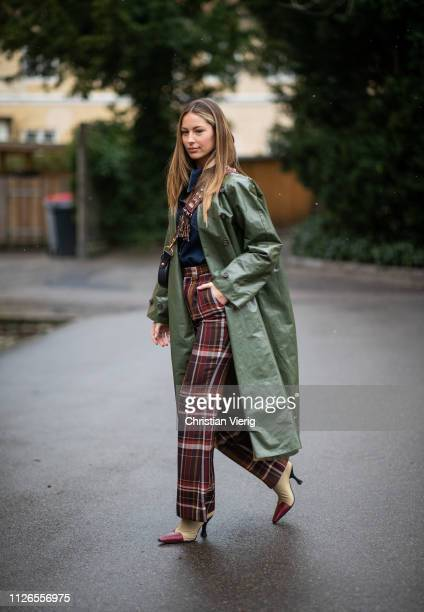 Mathilde Gøhler is seen wearing olive coat, checked pants outside By Malene Briger during the Copenhagen Fashion Week Autumn/Winter 2019 - Day 3 on...