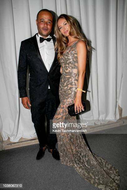 Mathilde Gohler and Remee Jackman are seen during the cocktail reception of amfAR Gala at La Permanente on September 22 2018 in Milan Italy