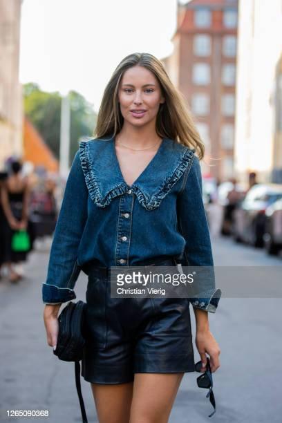 Mathilde Gohler is seen wearing denim jeans shirt black shorts Prada bag outside Ganni during Copenhagen Fashion Week Spring Summer 2021 on August 10...