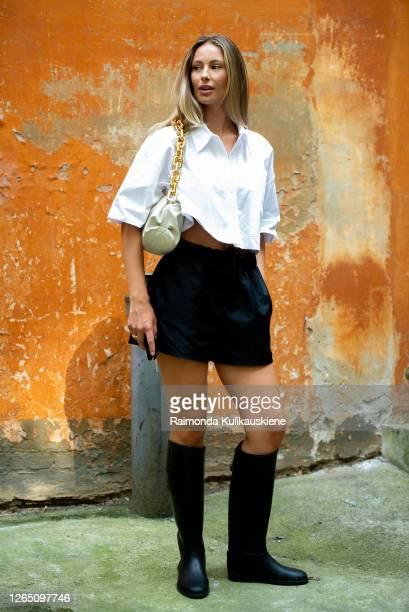 Mathilde Gohler outside Designers Remix wearing white shirt, Lovechild black shorts, Bottega Veneta bag and Designers Remix boots in Copenhagen...