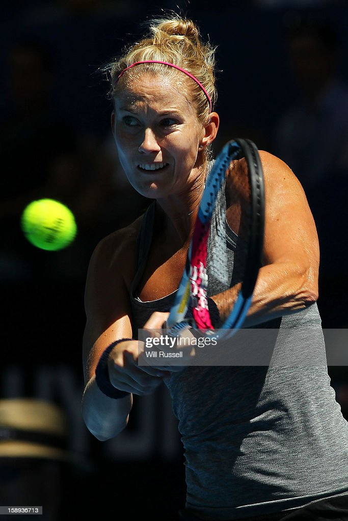 Mathilde Johansson of France hits a backhand in her singles match against Chanelle Scheepers of South Africa during day seven of the Hopman Cup at Perth Arena on January 4, 2013 in Perth, Australia.