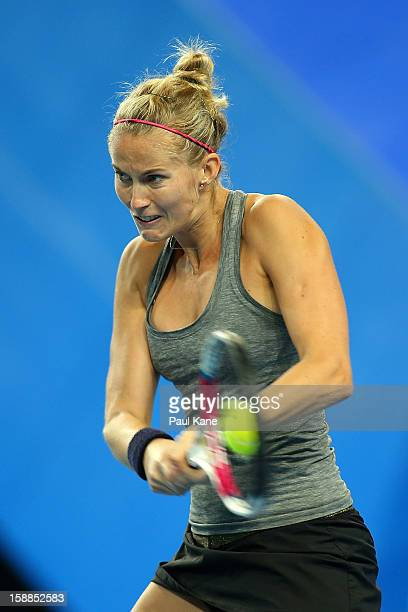 Mathilde Johansson of France plays a backhand to Venus Williams of the USA in her singles match during day four of the Hopman Cup at Perth Arena on...