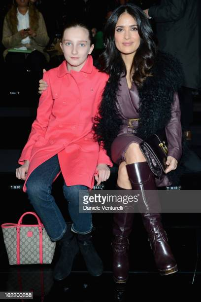 Mathilde Pinault and Salma Hayek attend the Gucci fashion show as part of Milan Fashion Week Womenswear Fall/Winter 2013/14 on February 20 2013 in...