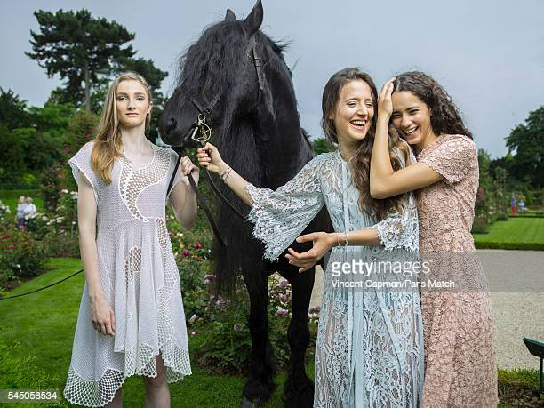 Mathilde Pinault Flore Giraud and Iman Perez are photographed for Paris Match with a horse called Le Frison in the Bagatelle gardens on June 22 2016...