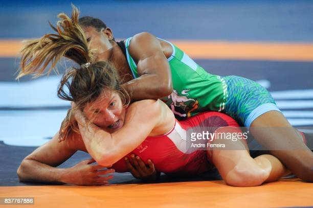 Mathilde Riviere of France and Odunayo Folasade Adekuoroye of Nigeria during the female 55 kg wrestling competition of the Paris 2017 Women's World...