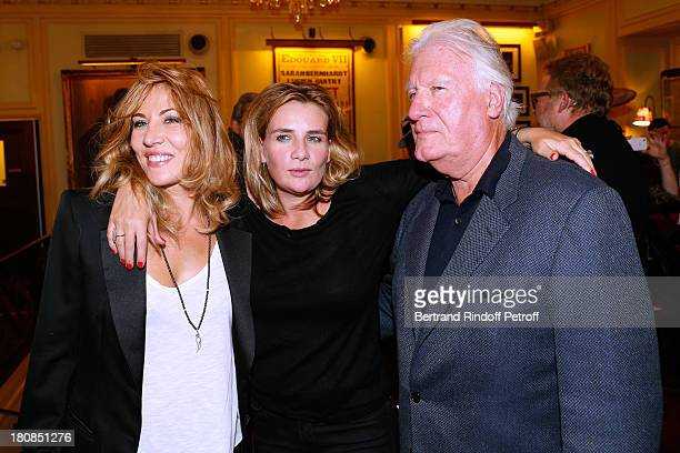 Mathilde Seigner her sister MarieAmelie Seigner and their father JeanLouis Seigner after 'Nina' Premiere at Theatre Edouard VII on September 16 2013...