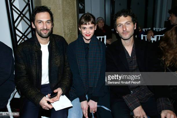 Mathilde Warnier sitting between Musicians Olivier Coursier and Simon Buret attend the Alexis Mabille show as part of the Paris Fashion Week...