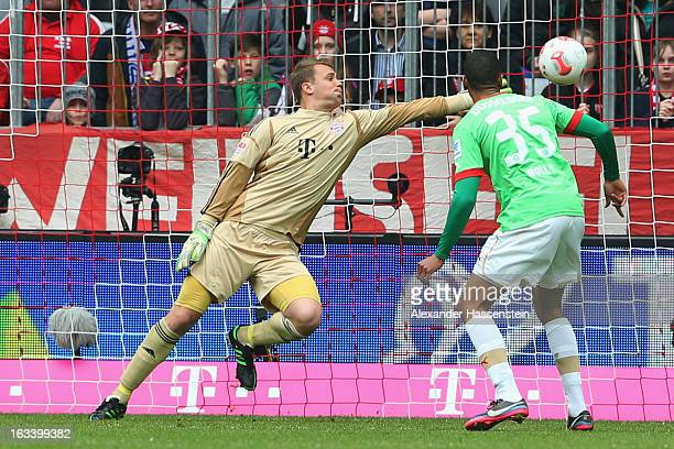 Mathis Bolly of Duesseldorf scores the opening goal against Manuel Neuer keeper of Muenchen during the Bundesliga match between FC Bayern Muenchen...