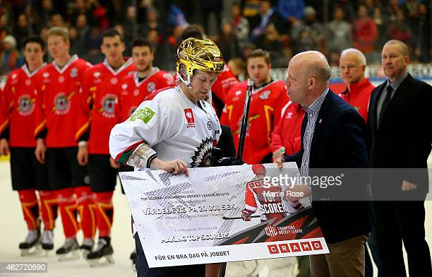 Mathis Olimb of Gothenburg receives the top scorer trophy after the Champions Hockey League final match at Coop Norrbotten Arena on February 3 2015...