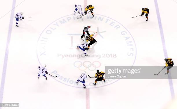Mathis Olimb of Norway and Patrick Hager of Germany face off in the first period during the Men's Ice Hockey Preliminary Round Group B game on day...