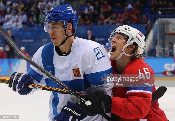 Mathis Olimb of Norway collides with Jori Lehtera of Finland in the third period during the Men's Ice Hockey Preliminary Round Group B game on day...