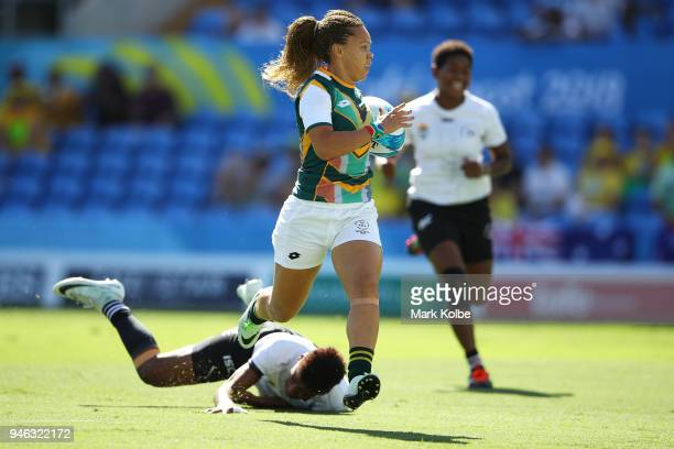 Mathrin Simmers of South Africa breaks away to score a try during the Women Placing 58 Rugby Sevens match between South Africa and Fiji on day 11 of...