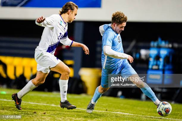 Mati Cano of Tufts Jumbos keeps the ball in bounds during the Division III Men's Soccer Championship held at UNCG Soccer Stadium on December 7 2019...