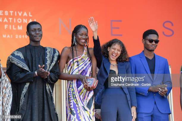 Mati Diop and the Cast of Atlantics attend the screening of Atlantics during the 72nd annual Cannes Film Festival on May 16 2019 in Cannes France