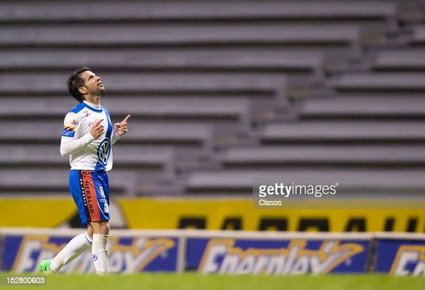 Matias Abelairas of Puebla celebrates a goal during a match between Puebla and Leon as part of the Apertura 2012 Liga MX at the Estadio Cuauhtemoc on...