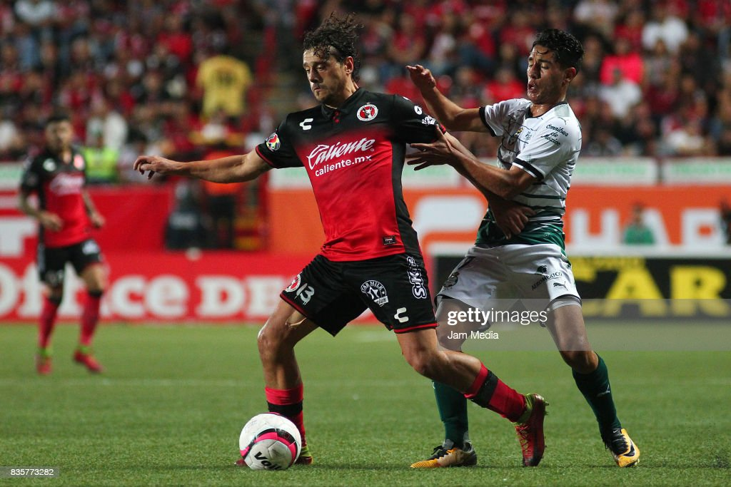 Matias Aguirregaray (L) of Tijuana and Walter Sandoval (R) of Santos Laguna fight for the ball during the fifth round match between Tijuana and Santos Laguna as part of the Torneo Apertura 2017 Liga MX at Caliente Stadium on August 18, 2017 in Tijuana, Mexico.