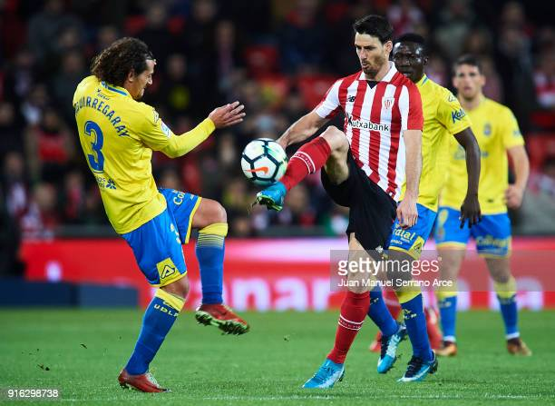 Matias Aguirregaray of Union Deportiva Las Palmas competes for the ball with Aritz Aduriz of Athletic Club during the La Liga match between Athletic...
