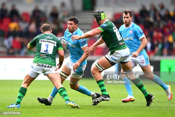 Matias Alemanno of Gloucester goes into contact with Allan Dell and Rob Simmons of London Irish during the Gallagher Premiership Rugby match between...