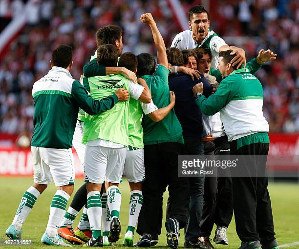 Matias Almeyda and his teammates celebrate their team's second goal converted by Juan Cazares of Banfield during a match between Estudiantes and...