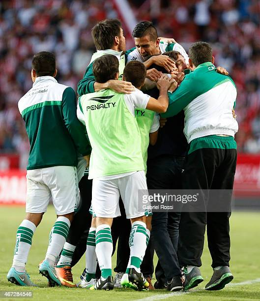 Matias Almeyda and teammates celebrate their team's second goal converted by Juan Cazares of Banfield during a match between Estudiantes and Banfield...