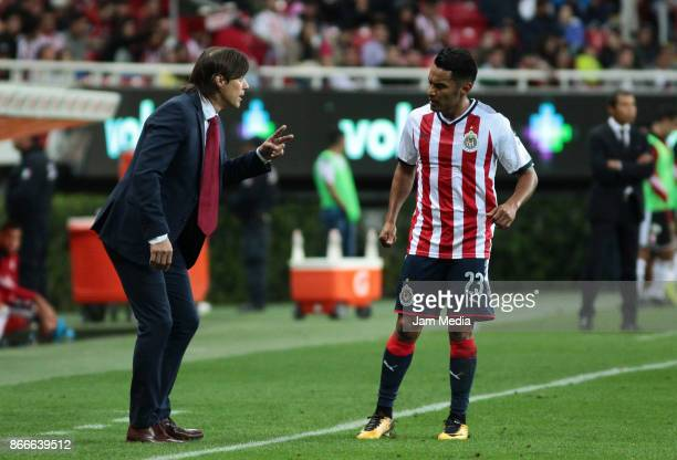 Matias Almeyda coach of Chivas gives instructions to his player Jose Vazquez during the round of sixteen match between Chivas and Atlas as part of...