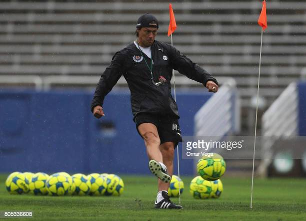 Matias Almeyda coach of Chivas kicks the ball during a training session prior to a friendly match between Chivas and Santos at Cotton Bowl Stadium on...