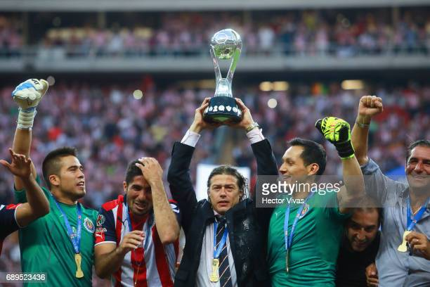 Matias Almeyda coach of Chivas lifts the champions trophy after the Final second leg match between Chivas and Tigres UANL as part of the Torneo...