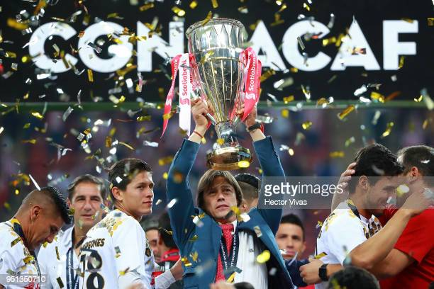 Matias Almeyda Head Coach of Chivas celebrates with the champions trophy after the second leg match of the final between Chivas and Toronto FC as...