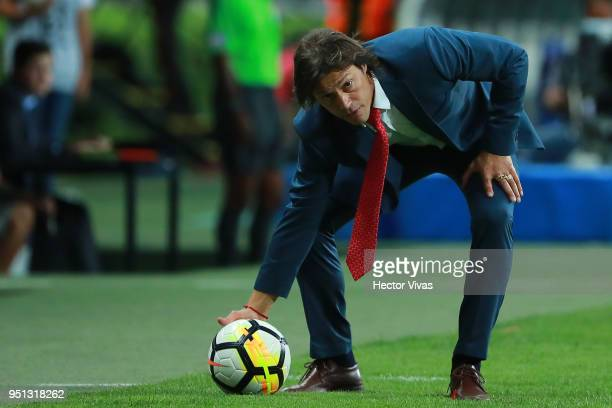 Matias Almeyda Head Coach of Chivas stops a ball during the second leg match of the final between Chivas and Toronto FC as part of CONCACAF Champions...