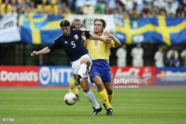 Matias Almeyda of Argentina holds off Anders Svensson of Sweden during the Argentina v Sweden Group F World Cup Group Stage match played at the...