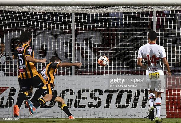 Matias Alonso of Bolivia's The Strongest heads the ball to score against Brazils Sao Paulo during their 2016 Copa Libertadores football match held at...